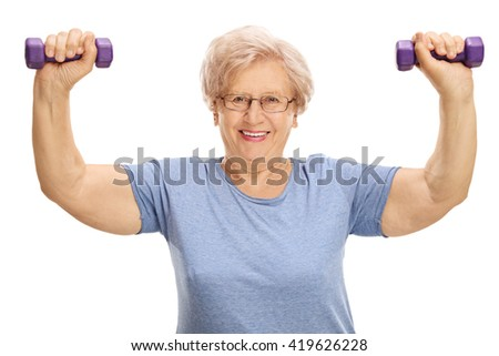 Mature woman exercising with two purple dumbbells isolated on white background - stock photo