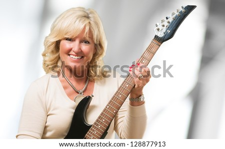 Mature Woman Holding Guitar, indoor