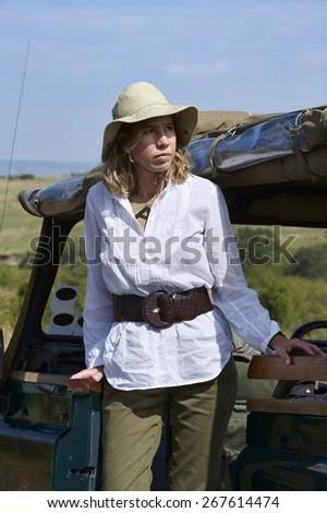 Mature woman in a safari in Kenya. - stock photo