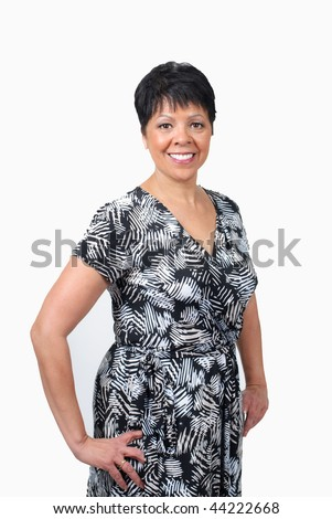 mature woman in black and white dress isolated on white - stock photo