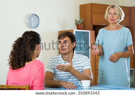 Mature woman is shocked of screaming between young couple