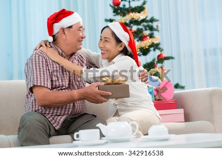 Mature woman is very happy to receive Christmas present from her husband