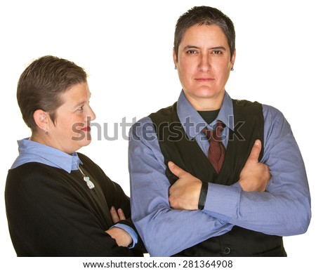 Mature woman looking at butch girlfriend in necktie - stock photo