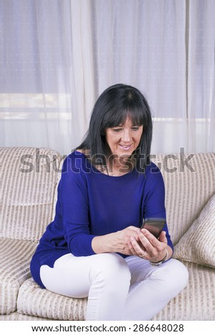 Mature Woman mobile phone query - stock photo
