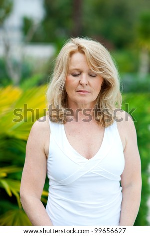 mature woman natural beauty portrait with closed eyes outside