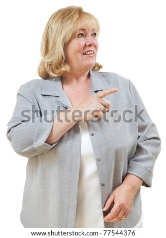 Mature woman pointing to one side - stock photo