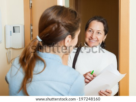 Mature woman polling among the population at door  - stock photo