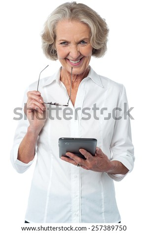 Mature woman posing with digital tablet