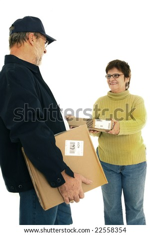 Mature woman receiving a package by a delivery man - stock photo