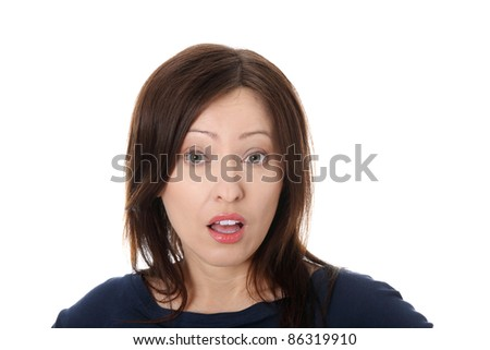 Mature woman shocked over white - stock photo