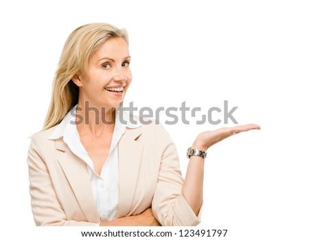Mature woman showing empty copy space isolated on white background