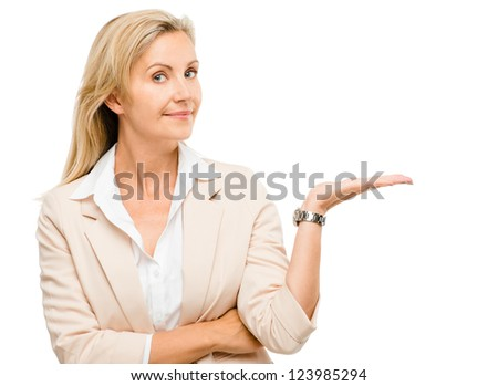 Mature woman showing empty copy space isolated on white background - stock photo