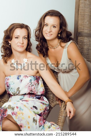 mature woman sisters twins at home interior - stock photo