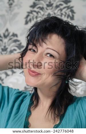 Mature woman smiling, portrait - stock photo