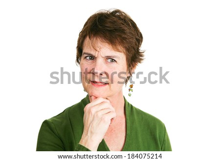 Mature woman thinking something over and looking confused or uncertain.  Isolated on white - stock photo