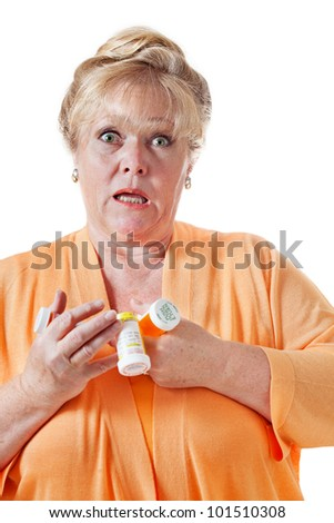 Mature woman trying to hold on to prescription bottles - stock photo