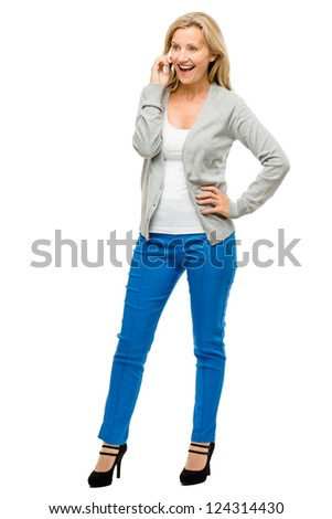 Mature woman using mobile phone isolated on white background - stock photo