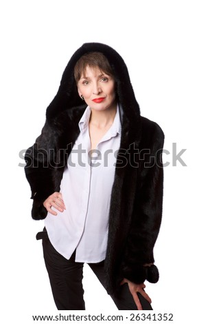 Mature woman wearing mink furs coat with hood isolated