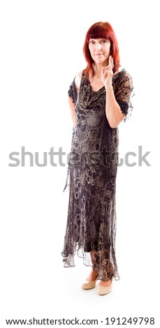 Mature woman wishing with crossing fingers - stock photo