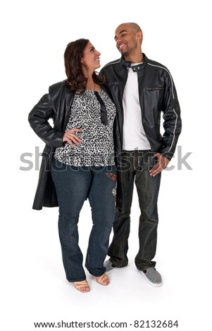 Mature woman with a younger man, smiling and looking at each other. - stock photo