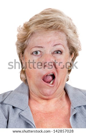 Mature woman with Bell's Palsy screaming with only half her face - stock photo