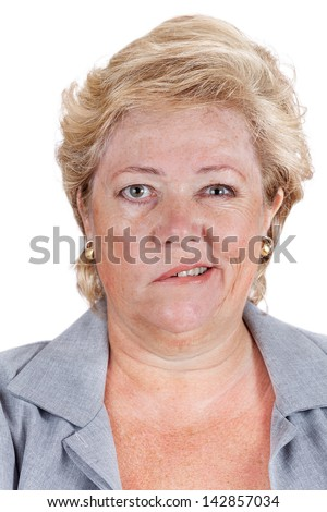Mature woman with Bell's Palsy smiling with only half her face - stock photo