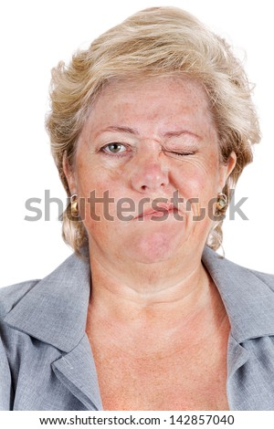 Mature woman with Bell's Palsy unable to scrunch up her right eye - stock photo