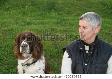 mature woman with dog - stock photo