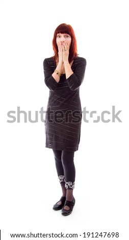 Mature woman with hand over her mouth - stock photo
