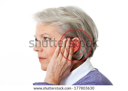 Mature woman with noise in the ear - stock photo