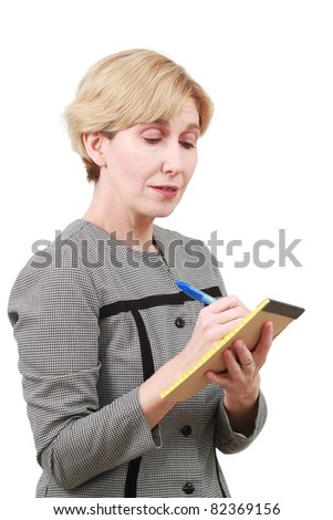 Mature woman with notepad - stock photo