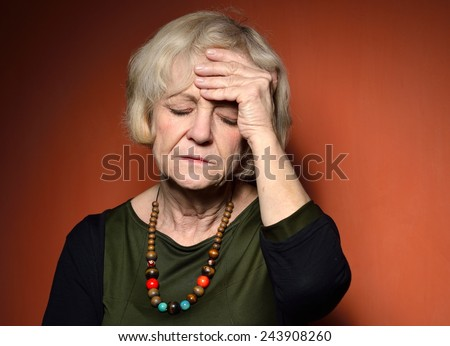 Mature woman with problems. - stock photo