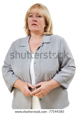 Mature woman wrinkles her brow in confusion - stock photo