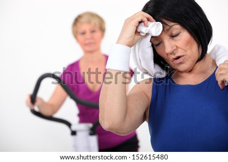 Mature women at the gym - stock photo