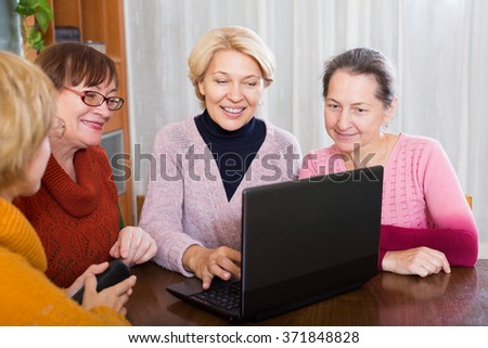 Mature women making accounts on date site at the home - stock photo