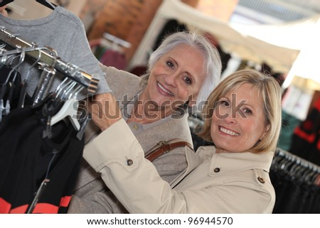 Mature women shopping. - stock photo