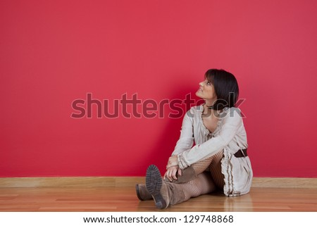 mature women sited in the floor of her new house - stock photo