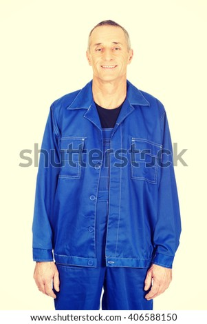 Mature worker in uniform - stock photo
