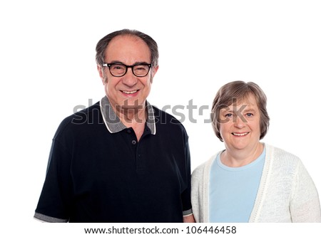 Matured couple posing. Husband and wife. Isolated over white