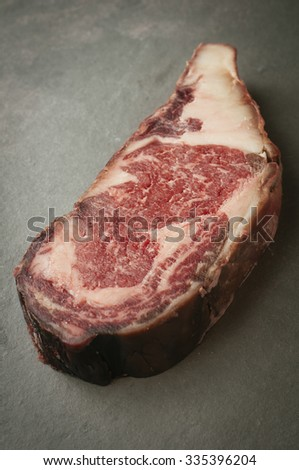 Matured piece of raw meat, beef dry edge - stock photo