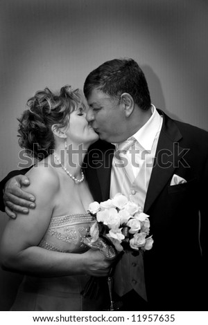 matured wedding couple having a moment - stock photo
