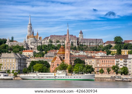 Matyas Church and the Fishermans Bastion overlooking the Danube River in Budapest - stock photo
