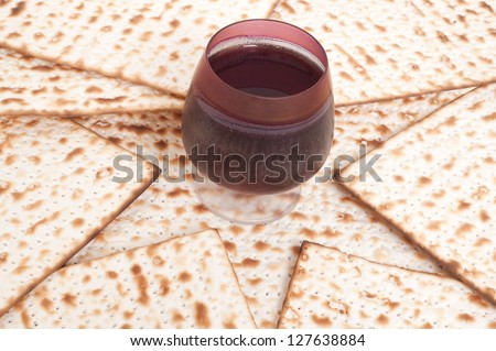 Matza bread for passover celebration and red wine - stock photo
