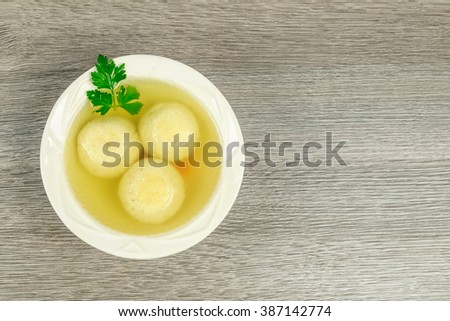 Matzah balls in a bowl of soup homemade healthy israelil - stock photo