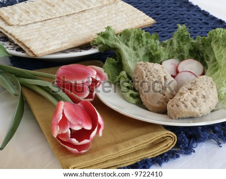 Matzo and gefilte fish meal with tulips - stock photo