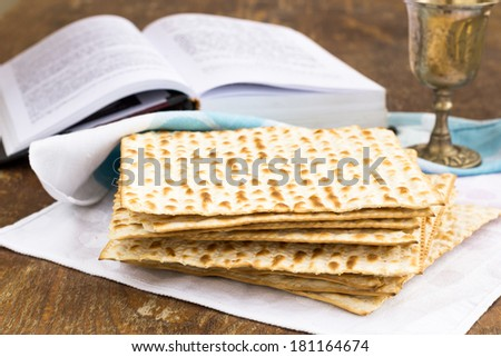Matzo and wine for passover celebration on a wooden surface - stock photo