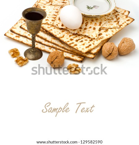 Matzo, egg, walnuts and wine for passover celebration on white background - stock photo