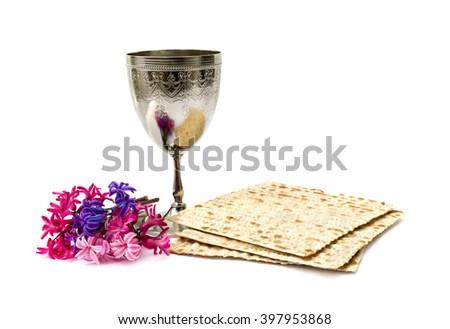 Matzo, wine and hyacinths for passover celebration on white background - stock photo