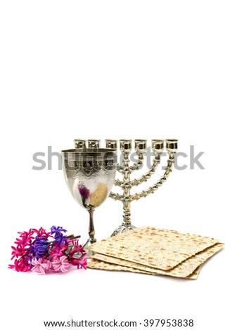 Matzo, wine, menorah and hyacinths for passover celebration on white background with space for text - stock photo