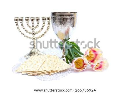 Matzo, wine, menorah and tulips for passover celebration on white background - stock photo
